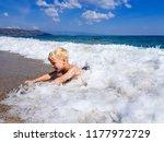 a little blond boy is playing... | Shutterstock . vector #1177972729