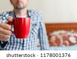 the man is holding morning cup... | Shutterstock . vector #1178001376