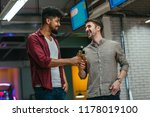 shot of two man cheering with...   Shutterstock . vector #1178019100