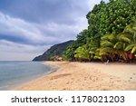 tropical beach under gloomy sky.... | Shutterstock . vector #1178021203