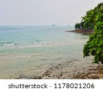 tropical beach under gloomy sky.... | Shutterstock . vector #1178021206