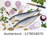 Stock photo salted herring with red onion bay leafs and parsley on the white background top view 1178028070