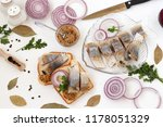 Stock photo snack from salted herring with red onion and mustard white background top view sliced herring on 1178051329