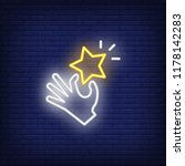 hand holding star neon sign.... | Shutterstock .eps vector #1178142283