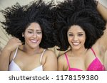 two young afro girls having fun ... | Shutterstock . vector #1178159380