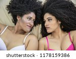 two young afro girls having fun ... | Shutterstock . vector #1178159386