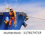 Small photo of Safety demonstration of Sprinkle from high, wear equipment protective PPE, on Forward Cargo ship repair by Scaffolding in stalled at forecastle deck for hull steel work in shipyard Thailand background