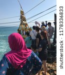 Small photo of Yogyakarta, Indonesia- September 10 2018 : Tourists queuing to take turn to ride gondola to get across the sea to small island called Timang. Gondola is a manually operated cart.