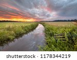 warm summer sunrise over... | Shutterstock . vector #1178344219