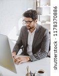 handsome businessman working at ... | Shutterstock . vector #1178370886
