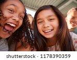 two schoolgirls and friends... | Shutterstock . vector #1178390359