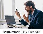 impulsive man yelling into the...   Shutterstock . vector #1178406730