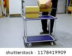 man collects cardboard boxes to ... | Shutterstock . vector #1178419909