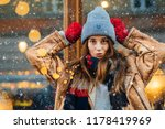 playfull smiling woman in warm...   Shutterstock . vector #1178419969