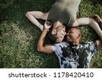 gay couple relaxing in the grass | Shutterstock . vector #1178420410