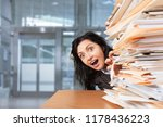 office worker raises and stack... | Shutterstock . vector #1178436223