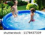 two cheerful cute little... | Shutterstock . vector #1178437339