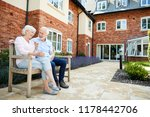 retired couple sitting on bench ... | Shutterstock . vector #1178442706