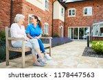 senior woman sitting on bench... | Shutterstock . vector #1178447563