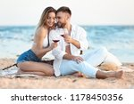 young couple with glasses of... | Shutterstock . vector #1178450356