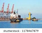 tugboat assisting bulk cargo...   Shutterstock . vector #1178467879