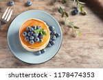 plate with pancakes and berries ... | Shutterstock . vector #1178474353