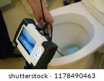 checking clogged toilet pipe... | Shutterstock . vector #1178490463