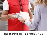 woman paying courier for... | Shutterstock . vector #1178517463