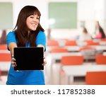 woman holding ipad  indoor | Shutterstock . vector #117852388