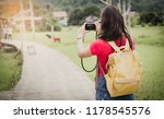 the girl is taking a picture.... | Shutterstock . vector #1178545576