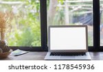 laptop on wooden table in cafe... | Shutterstock . vector #1178545936