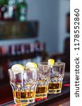alcohol drink on bar. tequila | Shutterstock . vector #1178552860