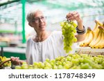 portrait of senior woman buying ... | Shutterstock . vector #1178748349