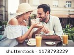 flirting in a cafe. beautiful... | Shutterstock . vector #1178793229