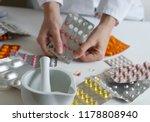 pharmacist at work. preparing... | Shutterstock . vector #1178808940