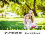 young mother with little... | Shutterstock . vector #117882139