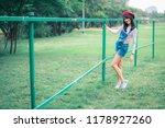 asian woman in grass smiling...   Shutterstock . vector #1178927260
