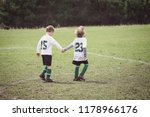 young soccer teammates holding...   Shutterstock . vector #1178966176