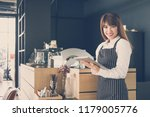 small business owner holding... | Shutterstock . vector #1179005776