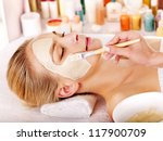 woman with clay facial mask in... | Shutterstock . vector #117900709