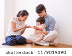 a child and the family who play | Shutterstock . vector #1179019390