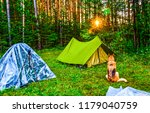 dog sitting next to tents in... | Shutterstock . vector #1179040759