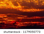 dramatic golden sky at the... | Shutterstock . vector #1179050773