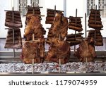 whole beef ribs on the barbecue.... | Shutterstock . vector #1179074959