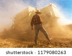 senior farmer in soybean field... | Shutterstock . vector #1179080263