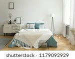 a big comfortable bed with pale ... | Shutterstock . vector #1179092929