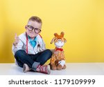 child playing doctor with toy... | Shutterstock . vector #1179109999