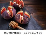 three figs stuffed with cheese... | Shutterstock . vector #1179117589