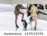 smiling young man opening door... | Shutterstock . vector #1179119290