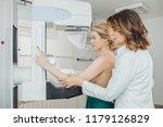 a woman having mammography... | Shutterstock . vector #1179126829